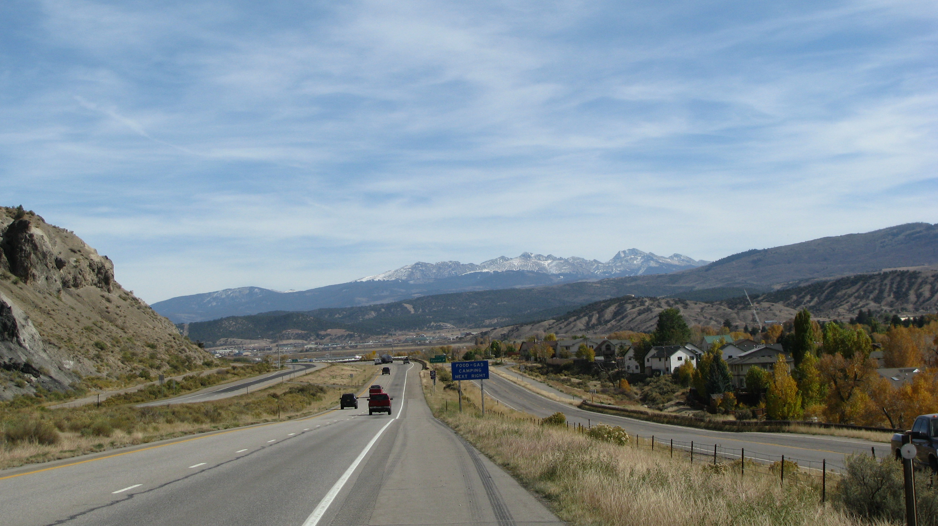 The scene while travelling eastbound when exiting Glenwood Canyon.  The mountains in the distance comprise the northern tip of the Sawatch Range, and the Holy Cross Wilderness