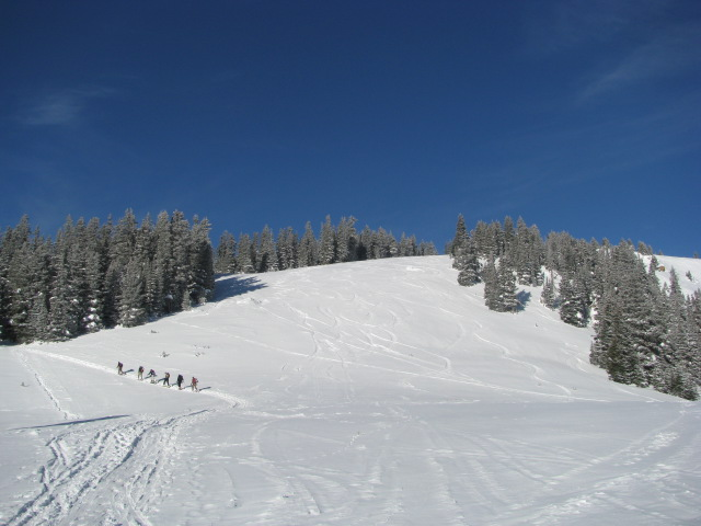 a train of skiers heading up